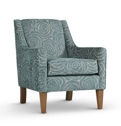 Duke armchair from Delcor in a beautiful teal patterned fabric. Handmade in the UK.