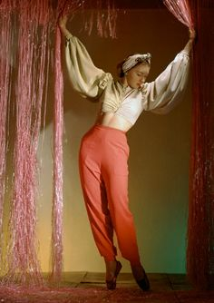 Dancer Irina Baronova standing under curtains wearing harlequin lounging pyjamas with narrow trousers and bare-midriff blouse - Vogue, July 1940 © Horst P. Monte Carlo, 1940s Fashion, Vintage Fashion, Vintage Style, Retro Style, Vintage Inspired, Horst P Horst, Dame Edna, Ballet Russe