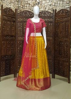Stunning yellow and red color combination pattu lehenga and blouse with red net dupatta. Blouse with hand embroidery kundan work. Order : Call/ Whats App us on +916305512969Mail : stylus.qak@gmail.comYOUR DESTINATION FOR ELEGANCE Stylus  06 December 2018 Netted Blouse Designs, Choli Blouse Design, Half Saree Designs, Pattu Saree Blouse Designs, Saree Blouse Patterns, Designer Blouse Patterns, Lehenga Designs, Dress Patterns, Long Gown Dress
