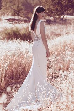 Gems accent the waist and low back of this bias-cut Wonder by Jenny Packham sheath wedding dress. Exclusively at David's Bridal.