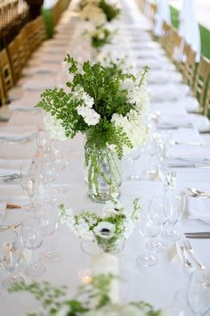 Long white tables filled with masses of white flowers and lots of greenery ~ really beautiful! Photography by Troy Grover Photographers, Florals by Fiori Floral & Event Designs