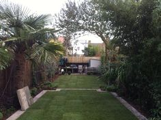 Back garden lined with trees. Make your home design dreams come true. Read reviews of 1000s of trusted tradesmen across the UK and get free quotes on MyBuilder.com.