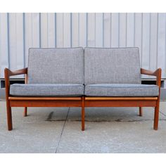 Find it at the Foundary - Illum Wikkelso Teak Loveseat-- my grandma had furniture like this