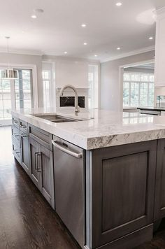 Traditional Kitchen with High ceiling, Kitchen island, Oak - Saddle 2 1/4 in. Solid Hardwood Strip, flush light, Raised panel