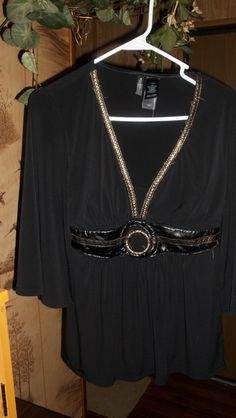 GORGEOUS! BLACK,FAIRY-STYLED BLOUSE WITH ATTACHED LEATHER BELT FOR A FABULOUS,SLIMMING LOOK!SZ.M/L: http://www.outbid.com/auctions/10348-fashion-s-first-retro-retail-groovy-gadgets-express-your-innerself-jewelry#28
