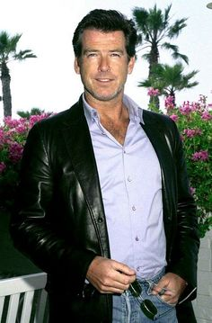 Men's Leather Jackets: How To Choose The One For You. A leather coat is a must for each guy's closet and is likewise an excellent method to express his individual design. Leather jackets never head out of styl James Bond Movies, Pierce Brosnan, Richard Gere, Raining Men, Irish Men, Hollywood Celebrities, Most Beautiful Man, Good Looking Men, Jacket Style