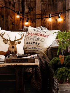 33 Cute Log Cabin Christmas Decorations Reindeer inspired pillows with rustic Christmas decor… I love the lights against the wood wall! Log Cabin Christmas, Christmas Love, Country Christmas, All Things Christmas, Winter Christmas, Woodland Christmas, Christmas Ideas, Christmas Recipes, Christmas Lights