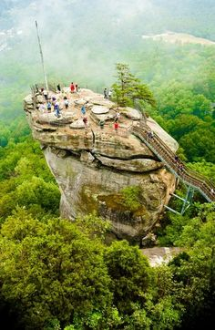 Climbing the Chimney Rock, North Carolina We drive. You climb. Unlimited destinations. Limitless options. You choose the ride.