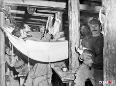 French marines, one holding a cat, shelter in a dugout on the Western Front.