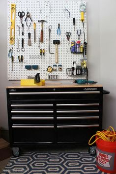 A Husky tool cabinet and some pegboard create an instant work bench for a garage or shed. We can't wait to see what awesome project come out of this well-organized workspace! From Melissa of The Inspired Room blog