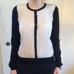 ⤵Dolce and Gabbana cardigan Adorable little black and white pokadot cardigan. Black back and dot front, button down in great shape. Silk and cotton, size 40, like a small/medium. NO TRADES. LOWEST PRICE, no offers accepted Dolce & Gabbana Sweaters Cardigans