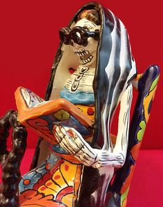 """La Catrina: Mexico's grande dame of death as """"Librarian"""" reading a book.  Perfect for Halloween / Day of the Dead. Dia De Los Muertos Traditional Holiday Folk Sculpture. Size: 6"""" x 8.5"""" x 3.5"""" From in Guanajuato, Mexico"""