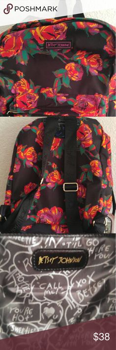 Betsey Johnson. Black orange backpack These is a BJ backpack with orange flowered roses all over it. It measures 17 inches in length and 13 inches across.It has a zippered pocket inside and on outside. Betsey Johnson Bags Backpacks