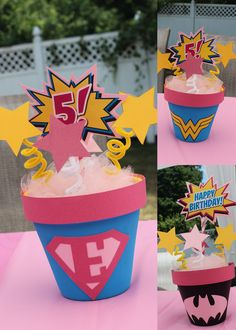 Emma's Superhero girl Birthday Party, DIY table Centerpieces. painted pots with cutout logos and signs designed by Paperkat Design