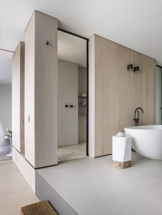 Powder room/laundry: tinted mirror wall panels, polished concrete ...