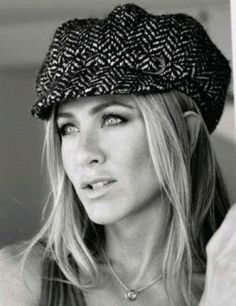 Love the hat. From her casual style to the red carpet, Jennifer Aniston has impeccable style.