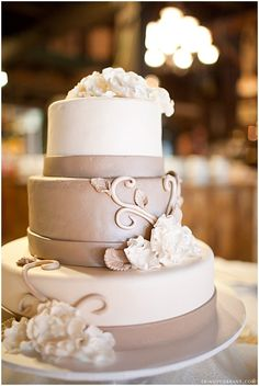 Gorgeous taupe wedding cake. Pretty but with silver instead.