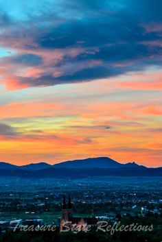 Sunset over Helena, Montana with the cathedral and the Sleeping Giant. Photo by Treasure State Reflections