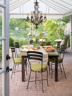dining alfresco a covered patio off the dining room is the perfect spot to enjoy amelie distressed chandelier perfect lighting