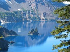 """Crater Lake in Oregon.  A must see if visiting Oregon!  This was a mountain that collapsed forming a caldera. The little rock formation shown here, I believe, is called """"phantom ship."""""""