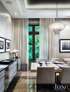 Dining room with metal chain chandelier | LuxeSource | Luxe Magazine - The Luxury Home Redefined