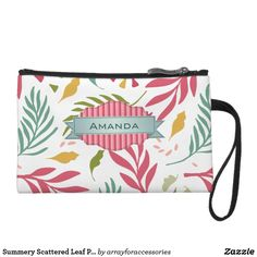 Summery Scattered Leaf Pattern ID387 Wristlet Wallet Scattered leaves in rose pink and shades of green and gold are the Hawaiian-flavored background for a beautiful banner label to hold your name or other text on this cheerful wristlet design. Search ID387 to see other products with this pattern.