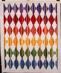 T-Rainbow Rhombus by Linda Rotz Miller Quilts & Quilt Tops, via Flickr...Log Cabin technique?