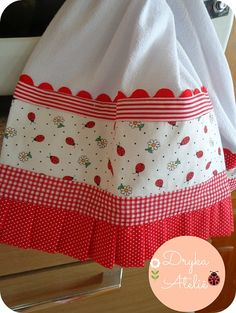 dish towel with rick rack, ribbon and fabric.