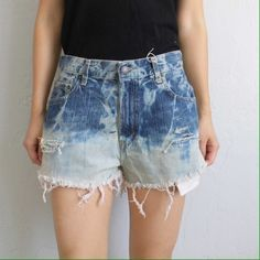"Tie Dyed High Waisted Levi's Shorts 29W These one of a kind, tie dyed shorts have been modified from a pair of Levi's Strauss denim jeans.  Measurements while lying flat:  Waist 14.5""  Rise 11.5"" Levi's Jeans"