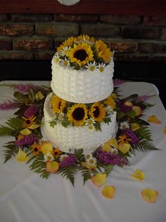 Purple And Sunflower Bouquets | Two tier wedding cake with sunflower topper and sunflower columns ...