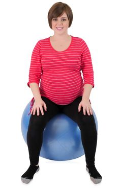 pregnant mother using a birth ball exercise