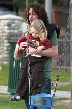 Musician Chris Cornell seen taking his son Christopher to the Coldwater Canyon Park in Beverly Hills. He met up with Jennifer Meyer and her daughter Ruby. Also Romeo Beckham runs by him at one point.