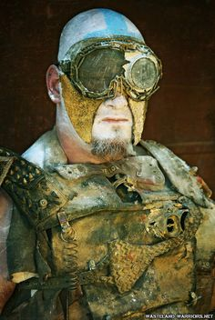 I like this as it could be a possible idea for an NPC within gaming. It fits the apocalypse/wasteland theme that I am looking for and the image gives me a myriad of ideas that fit my scrapyard world theme. Post Apocalyptic Clothing, Post Apocalyptic Costume, Post Apocalyptic Fashion, Apocalypse World, Post Apocalypse, Wasteland Warrior, Dystopia Rising, Wasteland Weekend, Badass Style