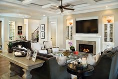 Great Room--really really love this and love the dark couches!! 2 couches and then 2 chairs on other side