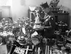 A U.S. soldier examines a solid gold statue, part of Hermann Goering's private loot, found by the 7th U.S. Army in a mountainside cave near Schonau am Konigssee, Germany, on May 25, 1945. The secret cave, the second found to date, also contained stolen priceless paintings from all over Europe. (AP Photo/Jim Pringle)