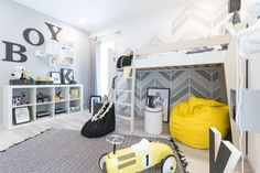 Bedroom for a boy. Ketara loft bed in black and white finishing. Made of birch plywood.