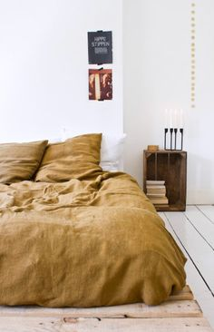 minimalist modern bedroom with brown linen bedding. #minimalist #minimalistmodern #bed #bedroom #bedding #linenbedding #bedlinens #paintedfloors #whitewashed #linen #bohemian #bohemianmodern #rustic