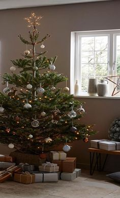 Give the classic Scandi style a festive twist. Select a real Christmas tree like. , Give the classic Scandi style a festive twist. Select a real Christmas tree like the Nordmann spruce and then hang earthy toned baubles, wooden textur. Minimalist Christmas Tree, Traditional Christmas Tree, Alternative Christmas Tree, Small Christmas Trees, Gold Christmas Tree, Christmas Tree Themes, Rustic Christmas, Simple Christmas, Christmas Traditions