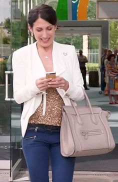Abby's white draped jacket, sequinned top and jeans on Girlfriends Guide to Divorce.  Outfit Details: http://wornontv.net/42556/ #GG2D