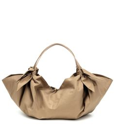 Designed for the modern bohemian, the Inda tote from Nanushka boasts a contemporary scarf-inspired structure. This lightweight style has been crafted from technical cotton blend in timeless beige, and is carried by two top . Tan Shoulder Bag, Candy Bags, Summer Bags, Modern Bohemian, Handmade Bags, Luxury Branding, Beige, My Style, Leather
