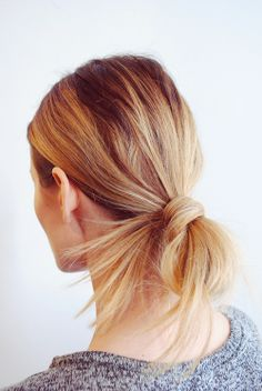 Pretty and simple long hairstyle tied back messy pony bun
