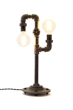 2 40 Watt Edison Bulbs offers subtle but brilliant ambient light. This lamp is constructed from industrial style black iron piping. The vintage bulbs are easy for anyone to change. Power is supplied b Pipe Lighting, Unique Lighting, Industrial Lighting, Chandelier Lighting, Industrial Style, Industrial Pipe, Lighting Ideas, Steam Punk, Edison Lampe