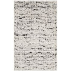 Lend lodge-chic appeal to your living room or den with this stylish rug, showcasing weathered details in ivory and silver hues. Pr...