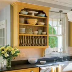 A cabinet without doors is a perfect way to display dishware and crockery. A plate rack on the bottom shelf offers a place for washed dishes to drip-dry. | Photo: courtesy of Crown Point Cabinetry | thisoldhouse.com