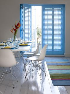 Sky blue shutters for a dining room. Source: www.shutterlyfabulous.com