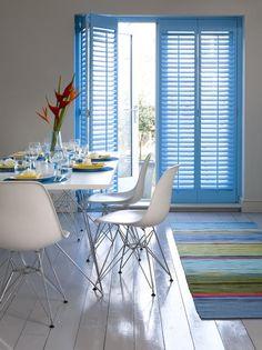 Sky blue shutters for a dining room. Source: www.shutterlyfabulous.com