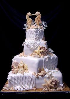 OK this is a beautiful beach wedding cake.