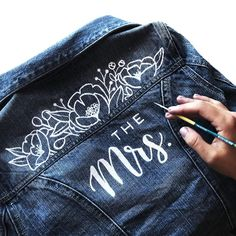 Double tap if youd totally rock a jean jacket like this over your wedding dress! So excited to be part of this fun project for the Mrs jacket! If youre in Ottawa and would do it theyve got rentals for you Painted Denim Jacket, Painted Jeans, Painted Clothes, Jeans Wedding, Wedding Jacket, Jean Jacket Outfits, Blue Jean Jacket, Looks Black, Team Bride