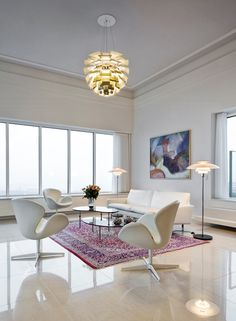 Danish penthouse with all white furniture and Louis Poulsen artichoke lamps
