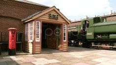 Vintage Steam Train Passing Building - Stock Footage | by Nigelb